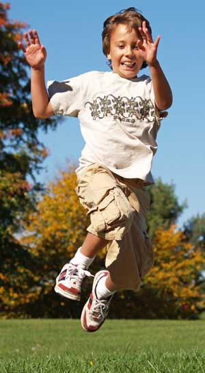 Images of a boy in a park jumping in the air